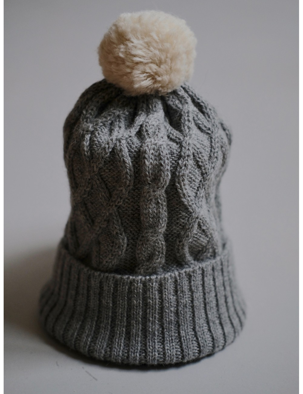 c2601d21374 Our Baby Alpaca wool hat is perfect for any occasion and easy to combine.  Super cute pom-pom hat in natural white and grey colours. Stay warm and cosy  with ...